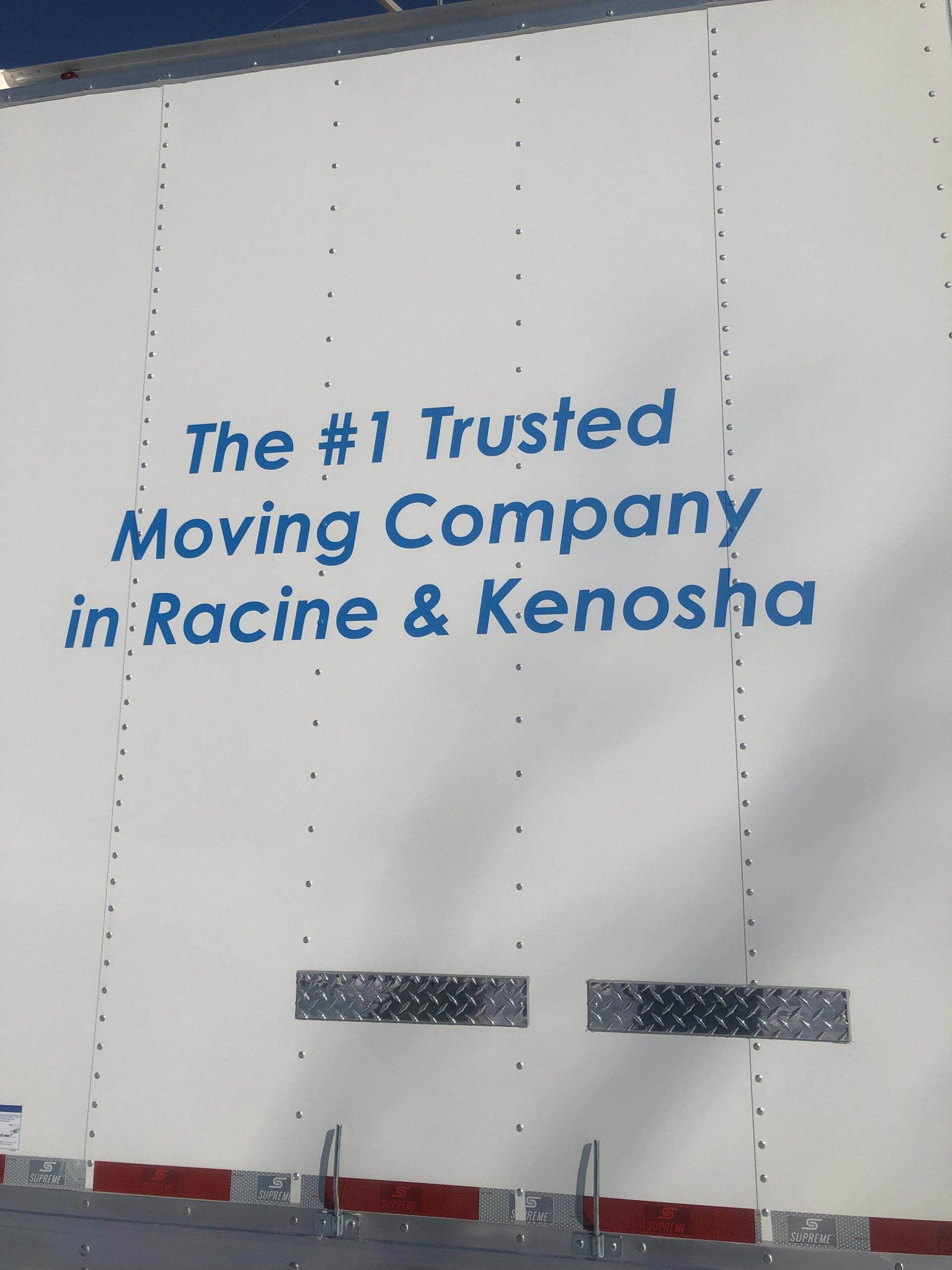 Back of moving truck with slogan